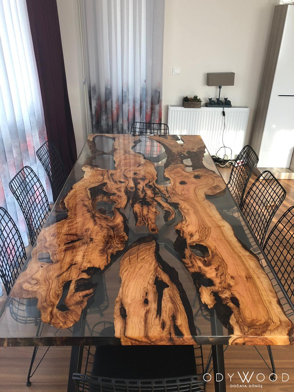 live-edge-olive-slab-dining-table-with-transparent-epoxy